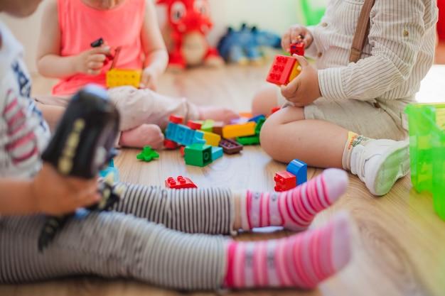 Crop children with toys Premium Photo