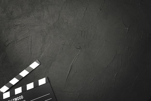 Crop clapperboard on black background Premium Photo