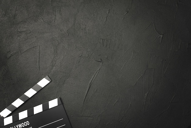 Crop clapperboard on black background Free Photo