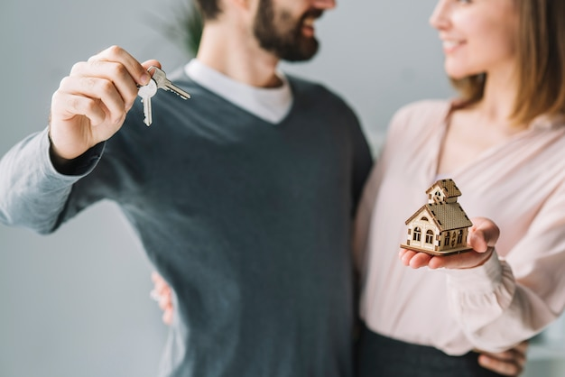 Crop couple with keys and house Free Photo