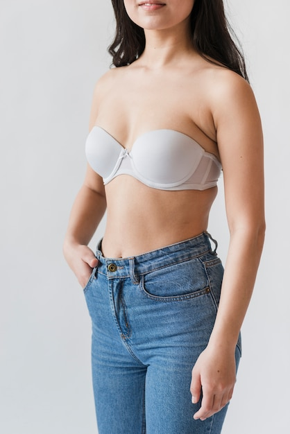 Crop of female in bra and jeans Free Photo