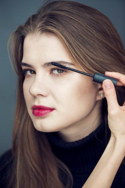 Crop Hand Applying Mascara On Eyelashes Of Model Photo Free Download