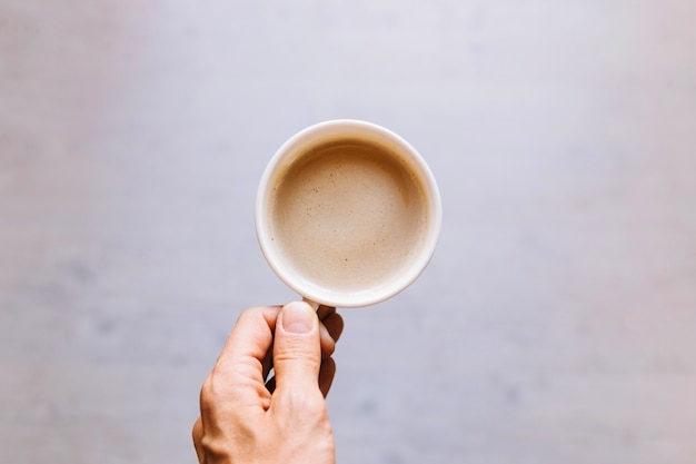 crop hand holding cup of coffee photo free download
