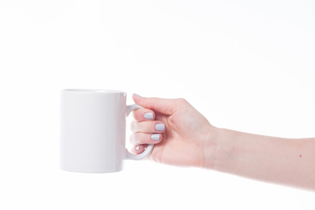 crop hand holding mug photo free download