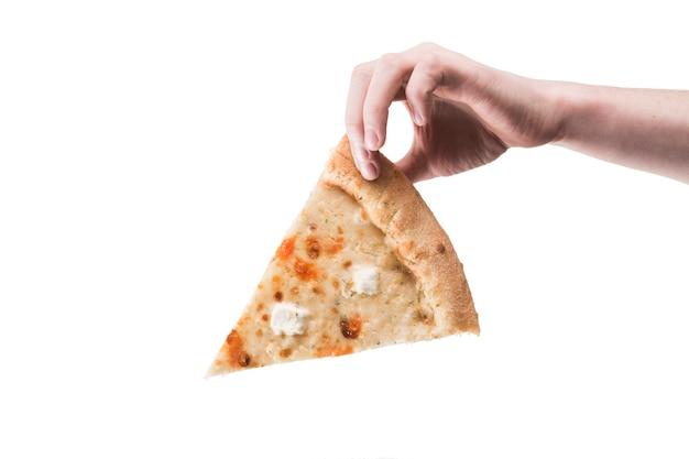 Mano che tiene la pizza in mano Foto Gratuite