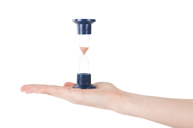 Crop hand showing hourglass Free Photo