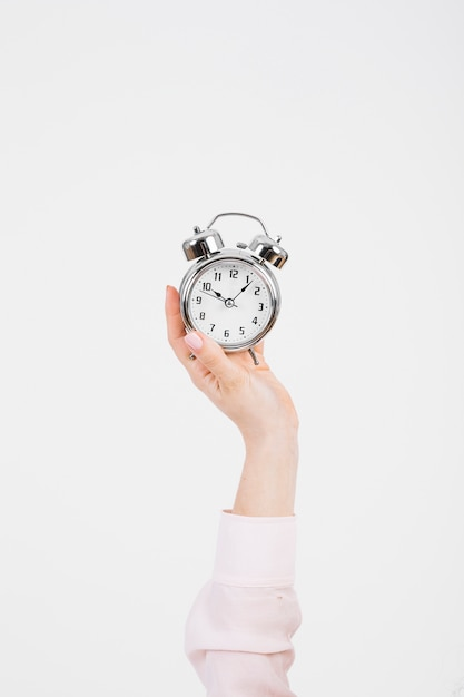 Crop hand with alarm clock Free Photo