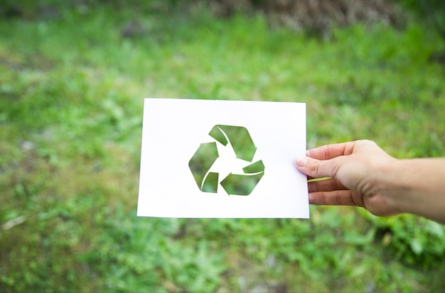 Crop hand with recycle symbol Premium Photo