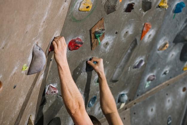 Crop hands on climbing wall 23 2147795601