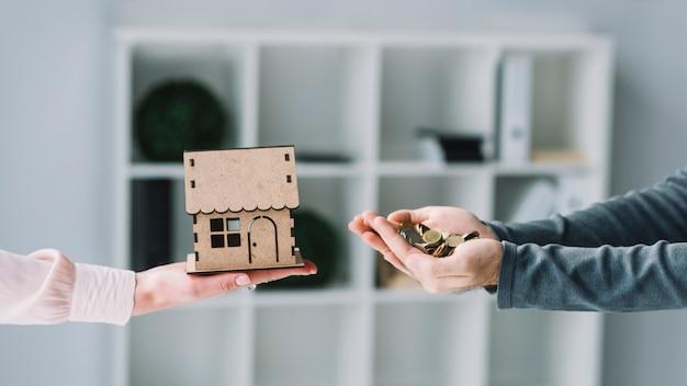استقرار الزوجية 2020 crop-hands-with-money-house_23-2147797607.jpg
