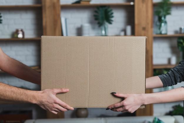 Crop hands with parcel Premium Photo