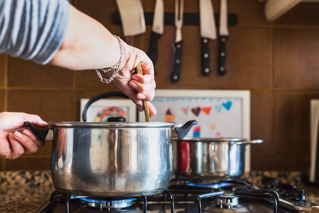 Crop hands of woman cooking in kitchen Free Photo