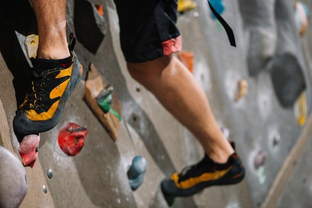 Crop legs on climbing wall Premium Photo