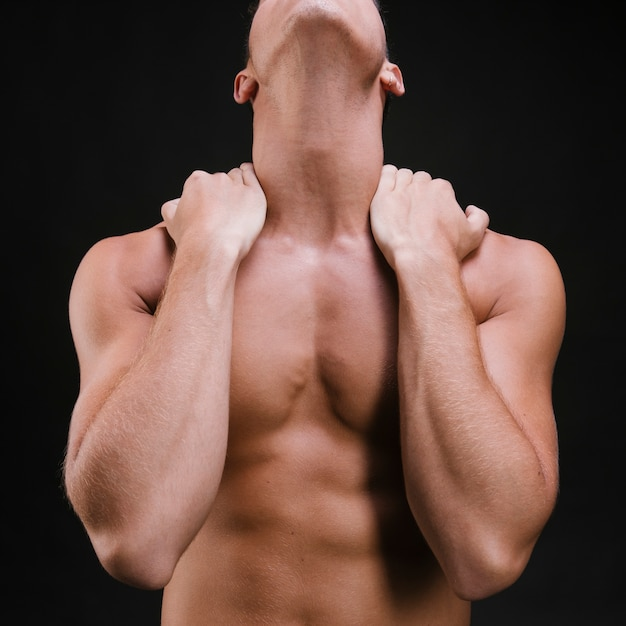 Crop man massaging neck and shoulders Free Photo