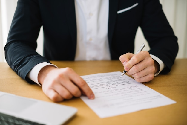 Crop man signing contract Free Photo