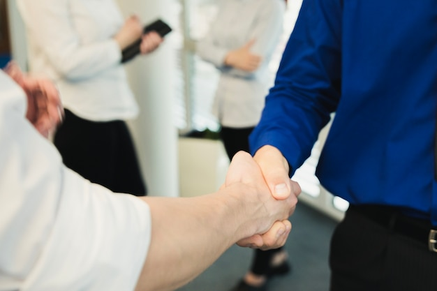 Crop shot of men shaking hands Free Photo