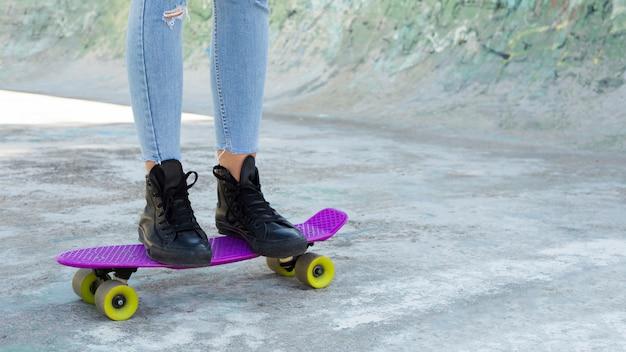 Crop view of young urban woman skating Free Photo