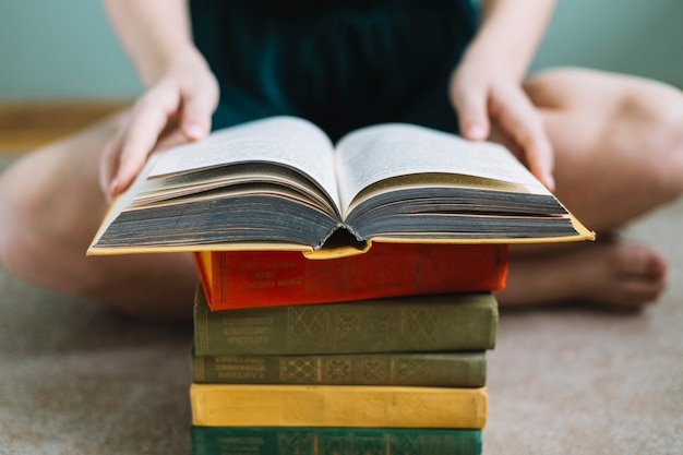 Crop woman reading old book Free Photo