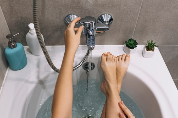 Crop woman relaxing in bath 23 2147787885