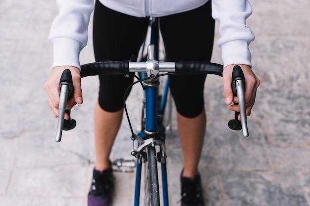 Crop woman riding bike 23 2147800956