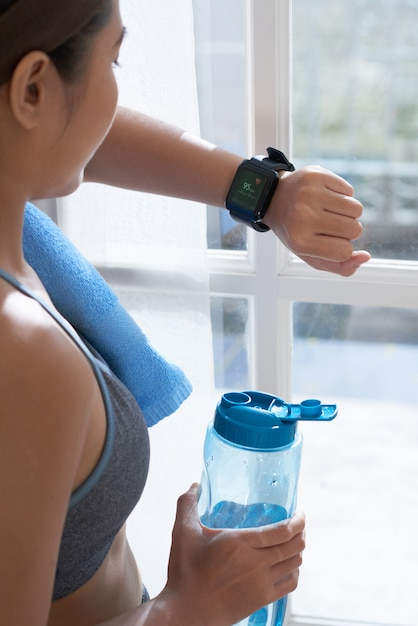 Crop woman watching smart watch Free Photo