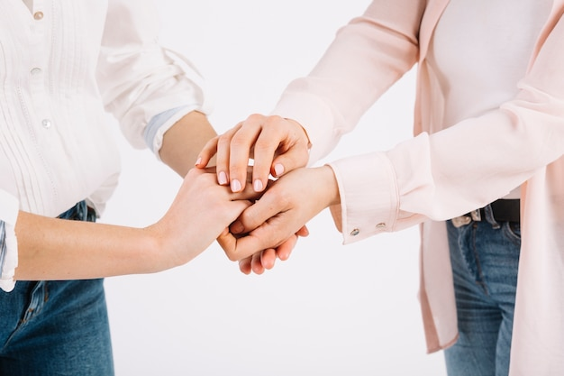 Crop women holding hands Premium Photo
