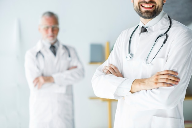 Crop young doctor standing in office Free Photo