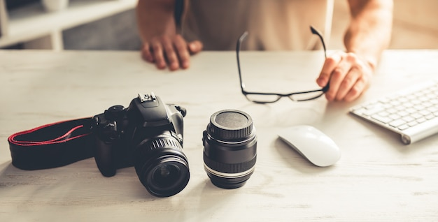 Cropped image of handsome young photographer. Premium Photo