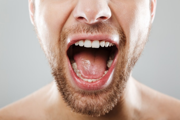 Cropped image of men's face screaming Free Photo