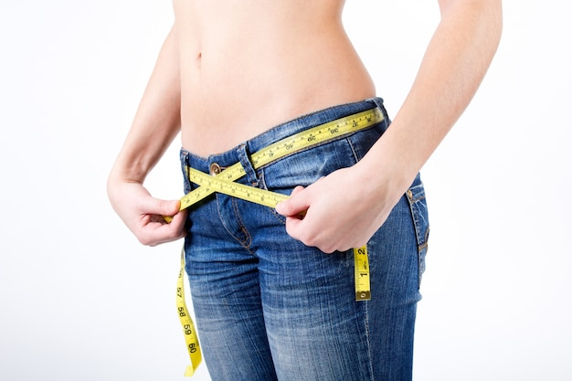 Cropped image of Woman measuring her waist Free Photo