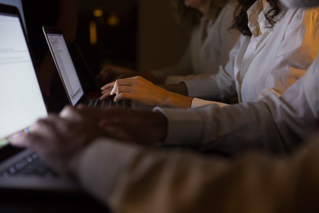 Cropped shot of business people working with laptops Free Photo