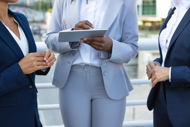Cropped shot of businesswomen with tablet pc Free Photo
