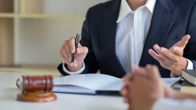 Cropped shot of lawyers give advice to clients in the law office Premium Photo