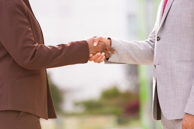 Cropped shot of two people shaking hands Free Photo