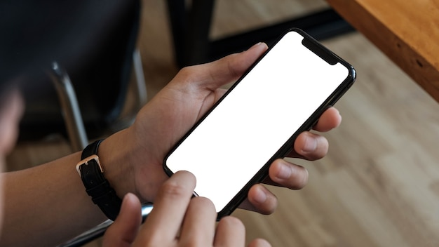 Cropped shot view of man hands holding smart phone with blank copy space screen for your text message or information content female reading text message on cell telephone during in urban setting. Premium Photo