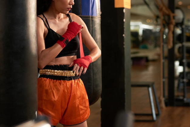 Cropped sportswoman preparing for boxing exercise in a gym Free Photo