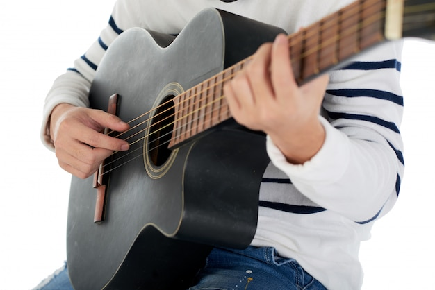 Cropped unrecognizable man playing the acoustic guitar Free Photo