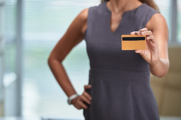 Cropped unrecognizable woman holding a bank card Free Photo