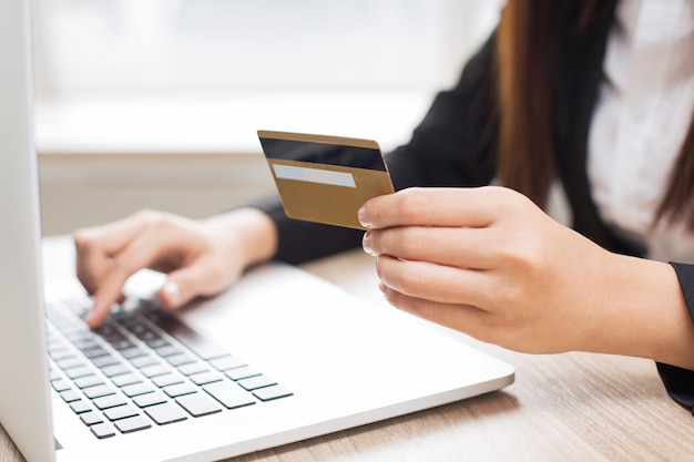 Cropped View of Woman Doing Online Banking Free Photo