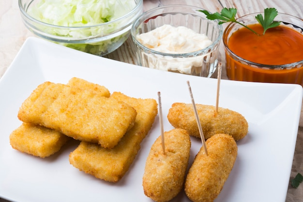 Croquettes balls and different kind of sauces on a plate Premium Photo