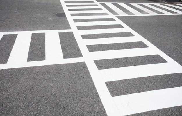 Crosswalk and cross way sign on the road Premium Photo