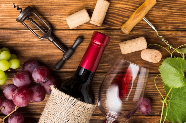 Crowded table with wine necessities Free Photo