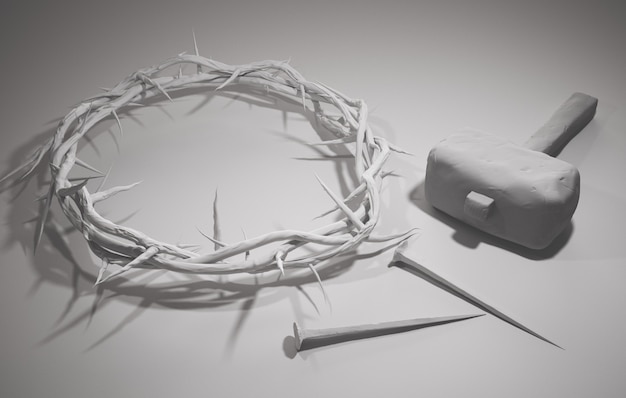 イエス・キリストの磔刑 - ハンマーで釘と棘の冠3dレンダリングの白い背景 Premium写真