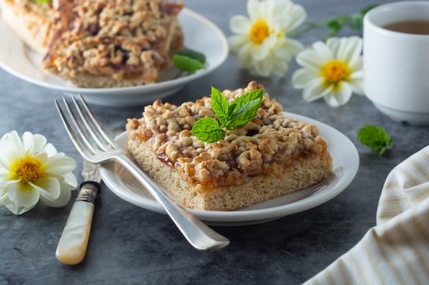 Crumble fruit pie, slice. homemade cake with fruit jam. delicious desert. Premium Photo