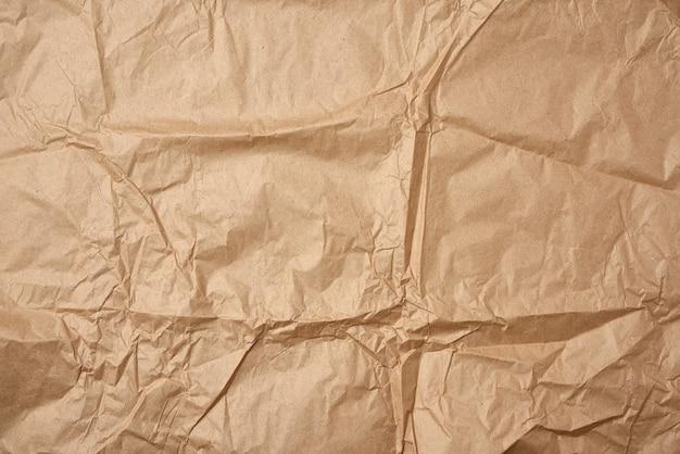 Crumpled blank sheet of brown wrapping kraft paper Premium Photo