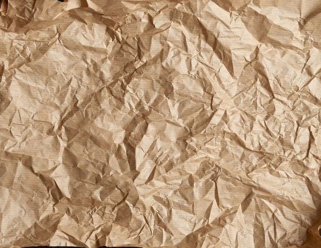 Crumpled brown parchment baking paper, full frame Premium Photo