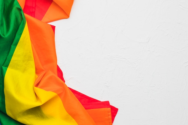 Crumpled multicolored cloth on white background Free Photo