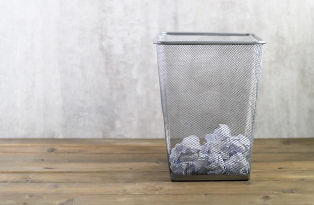 Crumpled paper in metal trash can Premium Photo