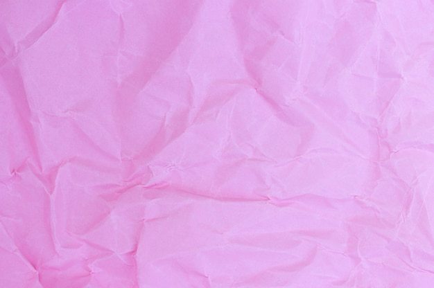 Crumpled paper pink pastel colors, texture, background Premium Photo