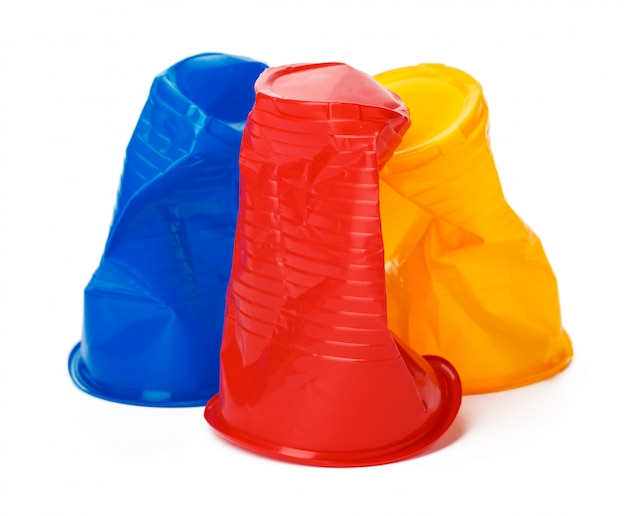 Crumpled plastic cup isolated Premium Photo